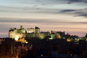 A floodlight view of Edinburgh Castle at twilight