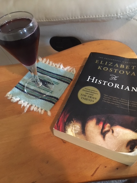 Book with glass of wine